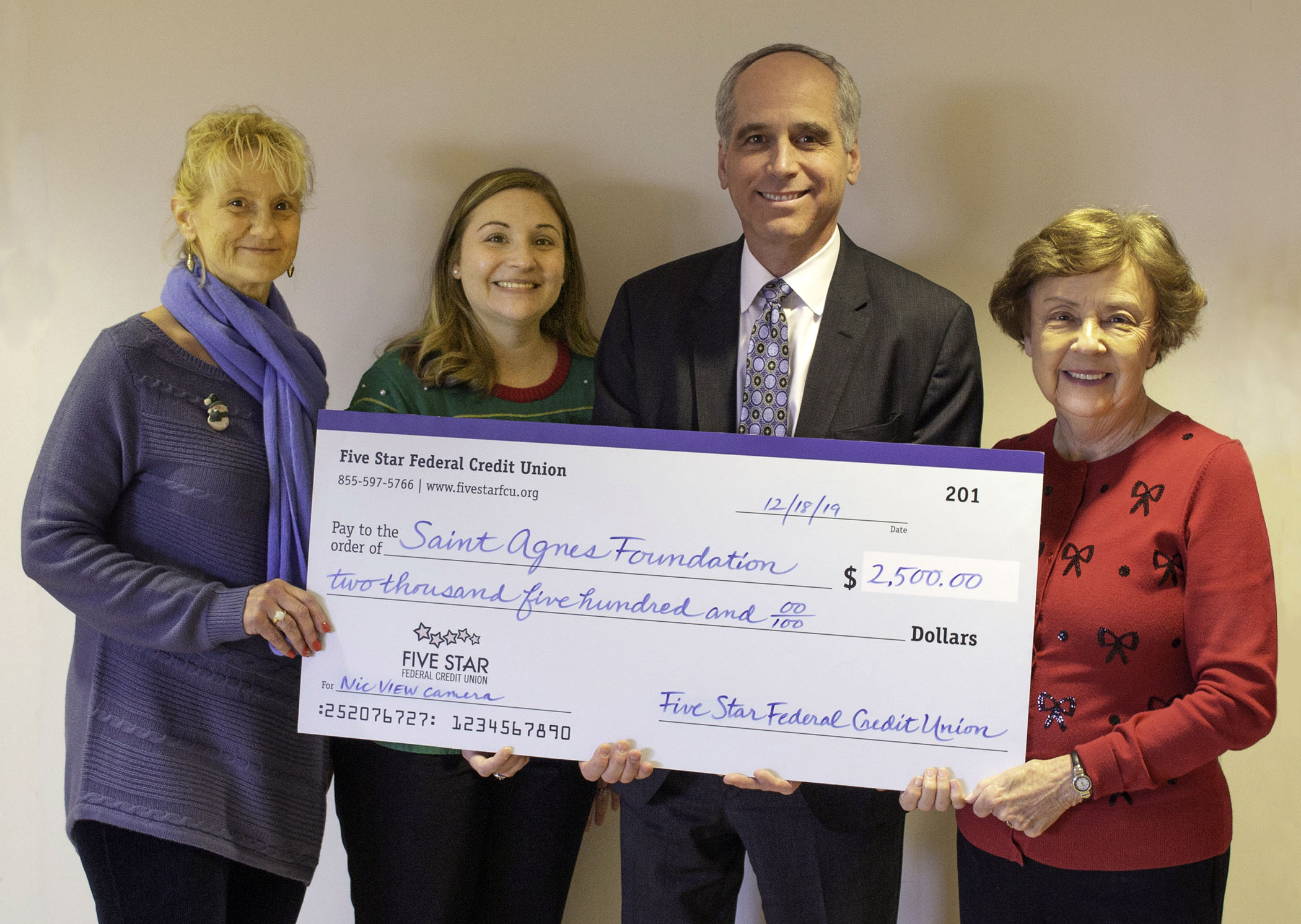 Five Star FCU presented a check for the hsopital's new NIC VIEW program.