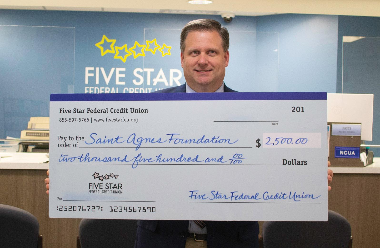 Five Star FCU presented a check for the Saint Agnes Foundation.