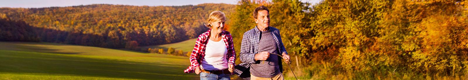 Couple running in autumn field