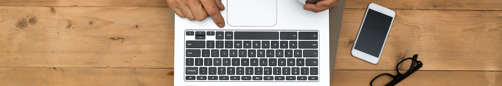 Computer keyboard with man's hand.